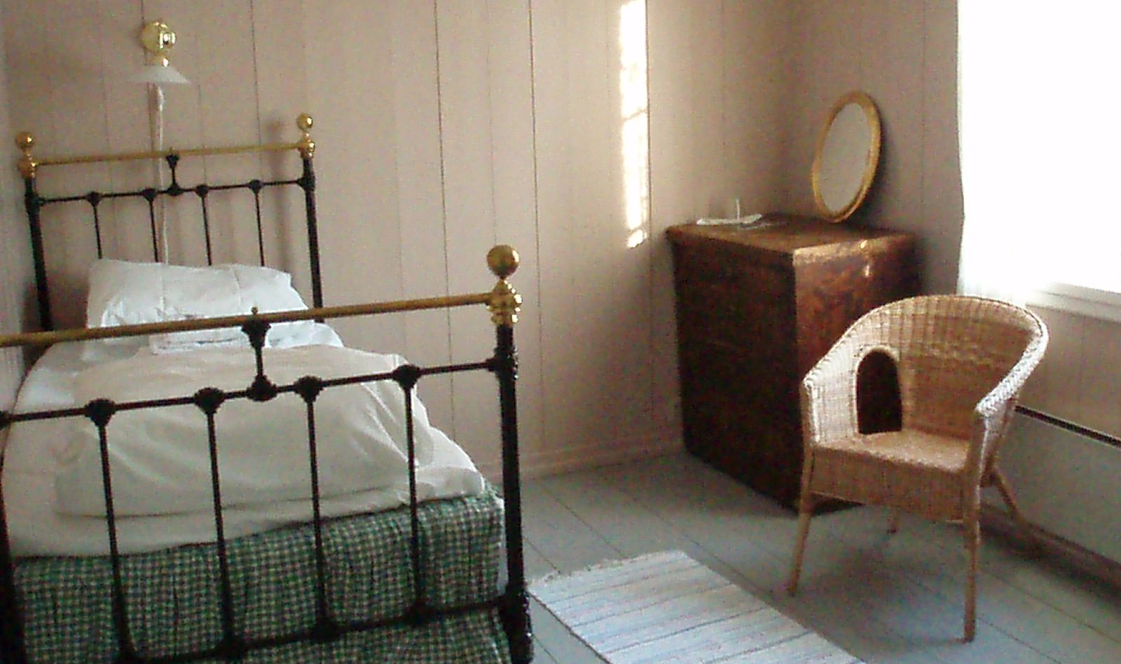 The bedrooms hold the cozy antique atmosphere.