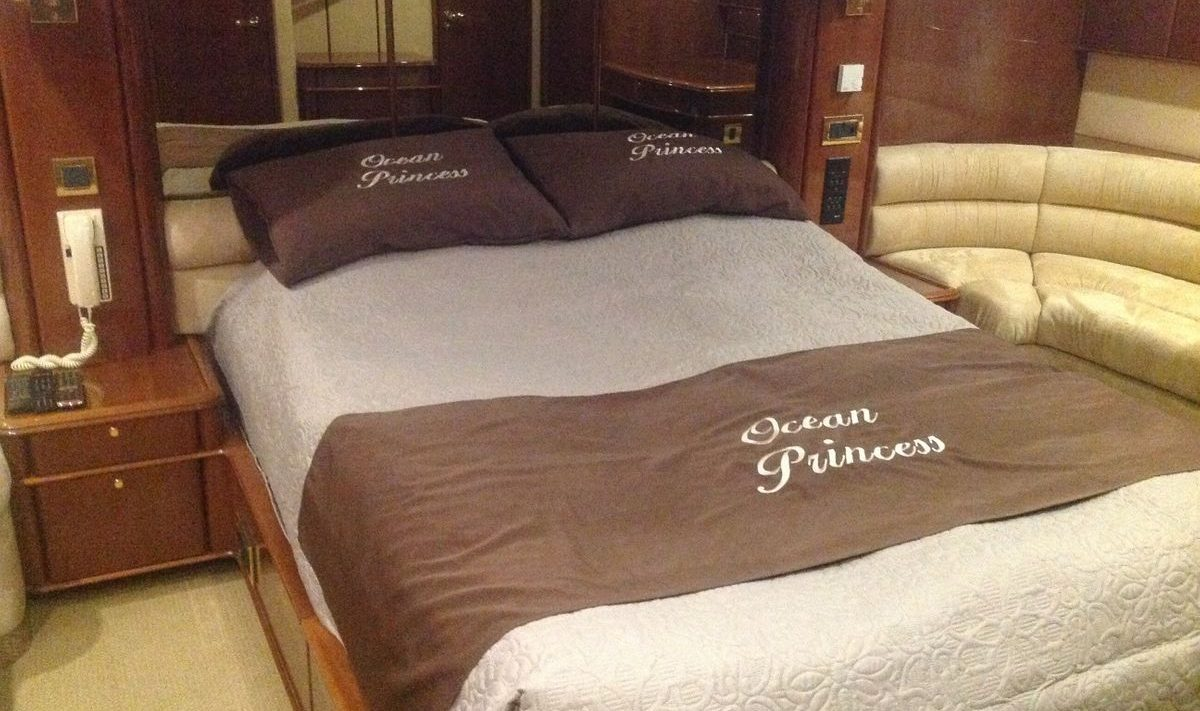 The yacht has a spacious master suite with a large bed